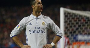 Real Madrid's Cristiano Ronaldo looks at Atletico supporters after scoring his side's third goal against Atletico Madrid during a Spanish La Liga soccer match between Real Madrid and Atletico Madrid at the Vicente Calderon stadium in Madrid, Saturday, Nov. 19, 2016. (AP Photo/Francisco Seco)